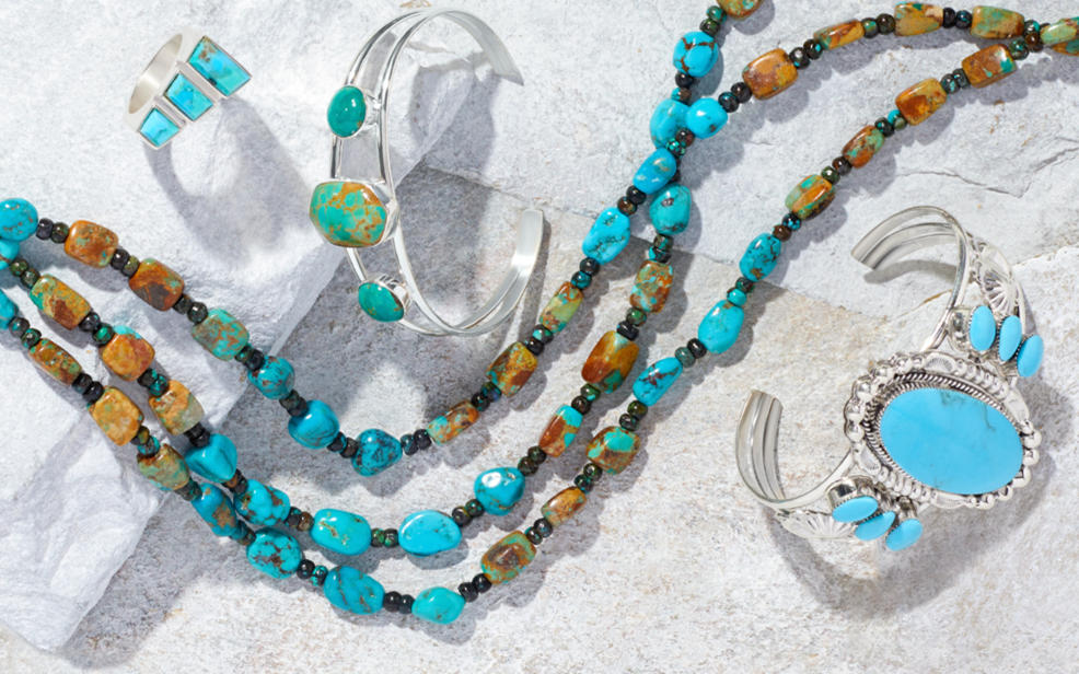A turquoise ring, bracelets and necklace.