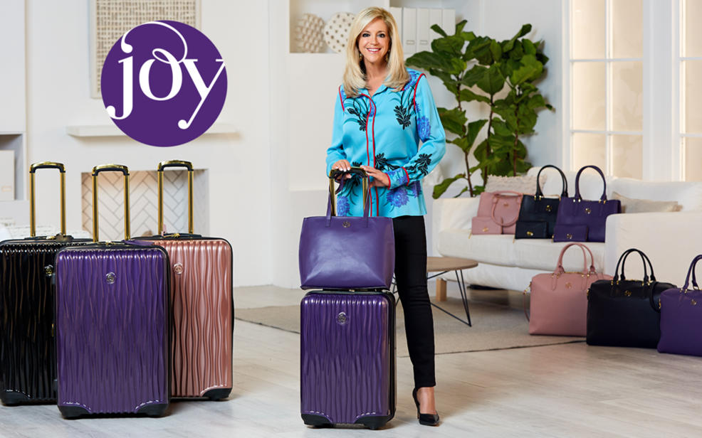 Joy logo. joy mangano shows off her luggage collection
