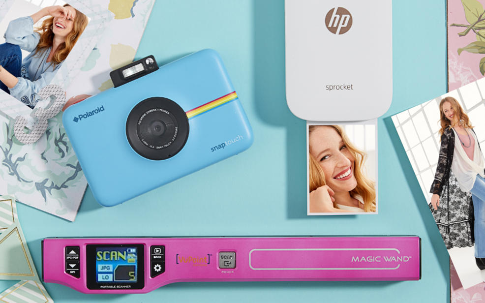 A Polaroid camera, a Magic Wand scanner, an HP Sprocket.