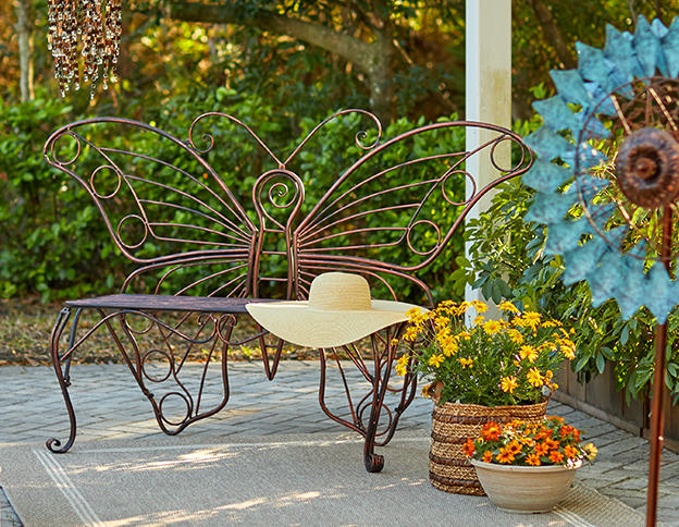 a butterfly shaped bench and a colorful windmill