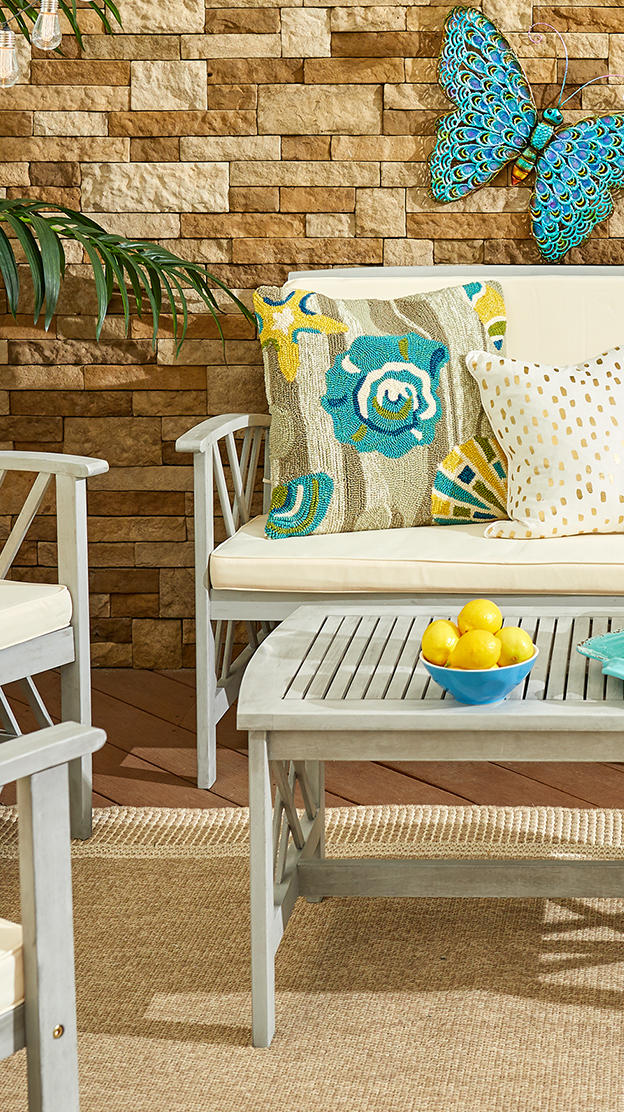 throw pillows on patio furniture and a jeweled
