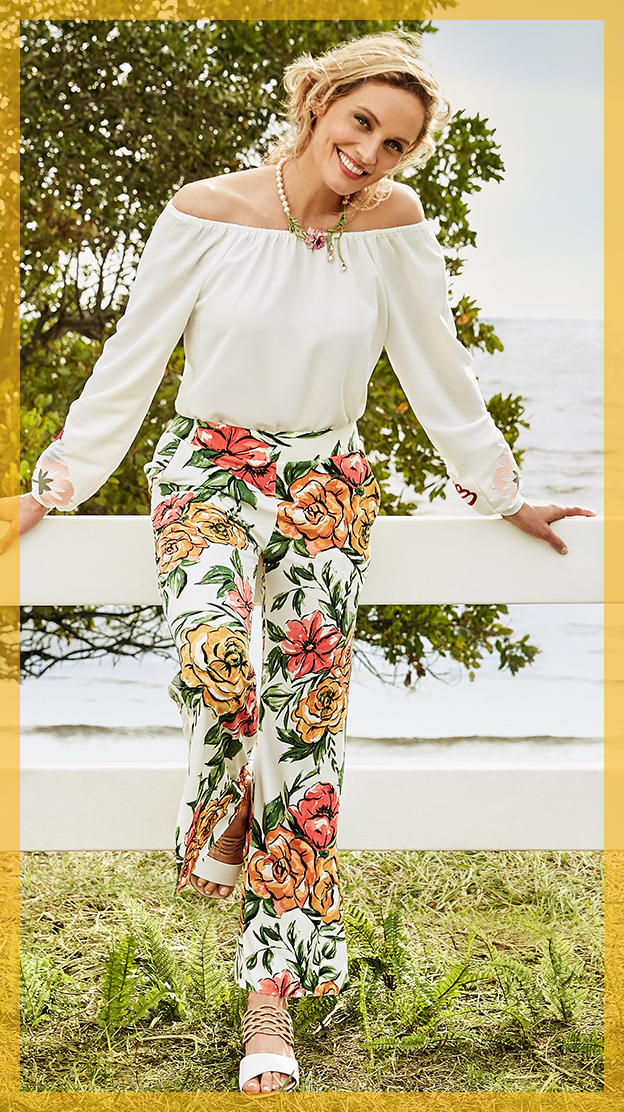 a woman in light floral pants