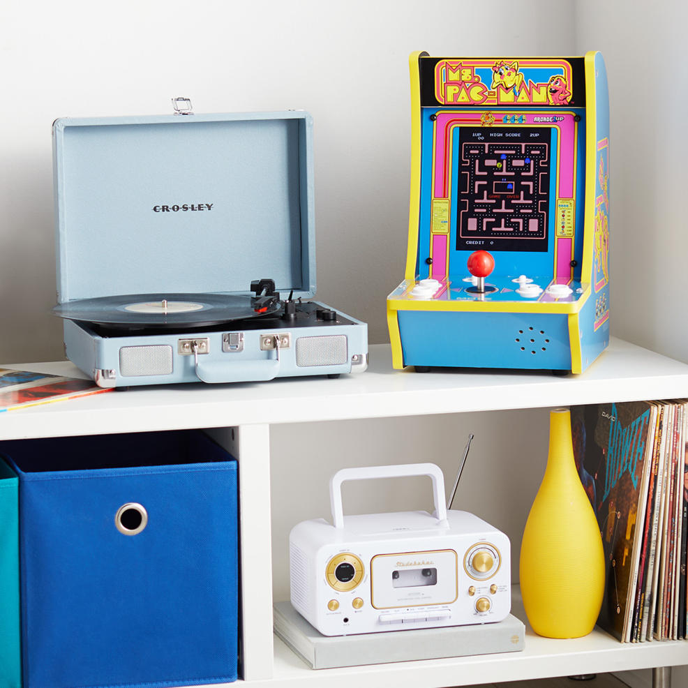 A record player, Ms Pacman, and a cassette tape player