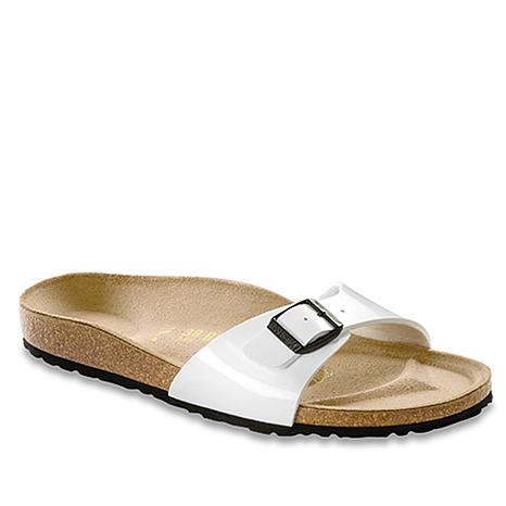A Birkenstock original sandal with a fully adjustable strap for a custom fit. Soft Birko-Flor™ synthetic upper with a leather-like finish (white patent has a high-gloss finish).